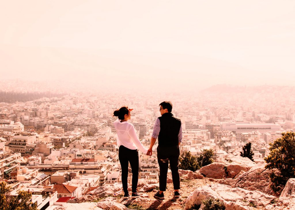 Tourists in Athens enjoying a view of the city.