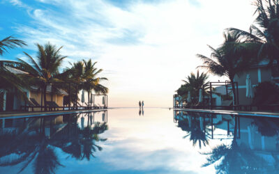 Couple watching the sunrise by the pool